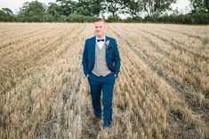 Image by Red On Blonde - Vintage wedding with 1920s inspired backless wedding dress and yellow and blue colour scheme. Groom with waistcoat & bow tie. Great Gatsby inspired wedding.