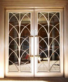 Art Deco doors dors for small wine cellar in dining room. have bronze doors