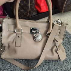 Michael Kors Hamilton bag This is the smaller to medium size bag it has the handles as well as a long strap to wear on shoulder. Michael Kors Bags