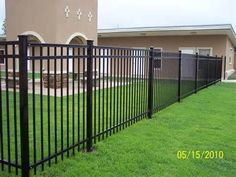 rod iron fencing designed to keep an animal contained inside. Need a tall fence Wrought Iron Fence Cost, Rod Iron Fences, Metal Fence Panels, Timber Fencing, Front Yard Fence, Pool Fence, Backyard Fences, Fenced In Yard, Fence Gate