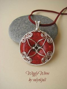 Wires Wiggly by sulyokjuli: Charm Red doughnut stone  scroll work, wire wrapped silver piece with wrapped bail