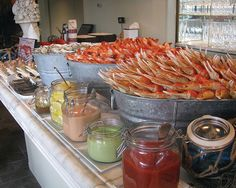 Our ever-changing Raw Bar; featuring oysters from both coasts, grilled-to-order lobster rolls, and Crab Louis Shooters