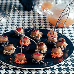 Mini Caramel Apples by Sunset Magazine. You get all the satisfaction of a caramel apple in one bite and without a messy chin. If decorating with twigs, make sure twigs are food-safe or use craft sticks. Caramel Apple Bites, Mini Caramel Apples, Apple Recipes, Fall Recipes, Holiday Recipes, Candy Recipes, Wine Recipes, Dessert Recipes, Dessert Ideas