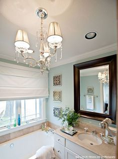 Pretty bathroom chandelier.  Would like to add one to our master bathroom.