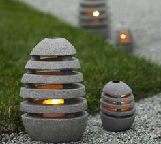 """Stone Egg Lantern... Slotted to illuminate in all directions, these oval stone lanterns open so you can insert a tealight or votive candle, depending on the size. The large lantern provides lighting for a pathway or stairs. Measures: 7""""L x 6""""W x 11.5""""H. Retails for $98."""