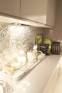 Cream and gray kitchen with reflective backsplash. This is just gorgeous! Elegant, classy, chic