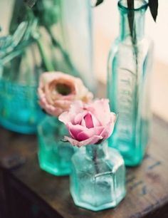 diy tinted vases: food coloring and gloss modpodge coated inside, held upside down to drain and baked on low heat to set.