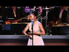 """Heather Headley performs Diana Ross' song """"Reach out and Touch"""" for former Presidents Clinton, George W. Bush, George H.W. Bush, and Jimmy Carter at Points of Light Tribute event."""