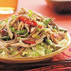 For extra crunch, serve this Asian noodle salad over a bed of shredded napa (Chinese) cabbage. Look for toasted sesame seeds on the spice aisle of your supermarket.Prep: 12 minutes; Cook: 6 minutes
