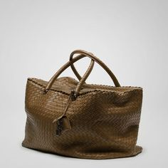 153afd4ef8031f The rectangular Brick has a pleasingly three-dimensional shape and two  woven leather handles. Ebanointrecciato Nappa Brick Bag W x H x D