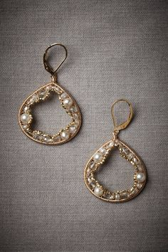 Geological Treasure Earrings from BHLDN. Like a glorious geode cracked open, quartz, freshwater pearls, Swarovski crystals, and sterling silver beads cling to the interior of a pair of wide teardrops. From Dana Kellin.