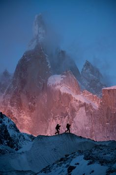 Morning light hits the 5-face of Cerro Torre, a Southern Patagonian Ice Field in South America by David Lama