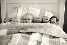 tucked in with dolls or teddy bears
