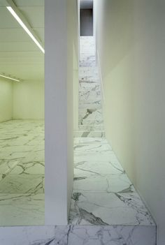 White calacatta marble staircase. Art gallery in Brussels, by Vincent Van Duysen.
