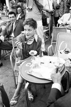 Romy Schneider enjoying ice-cream at Piazza San Marco in Venice, 1957. Photo by Max Scheler