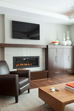 Modern Prairie - contemporary - Living Room - Minneapolis - REFINED LLC Fireplace, extended mantel, cabinetry