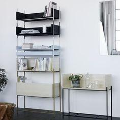 Skagerak, Denmark | Fluent Vivlio Shelving System.  Three heights of brass or steel legs stack on each other.