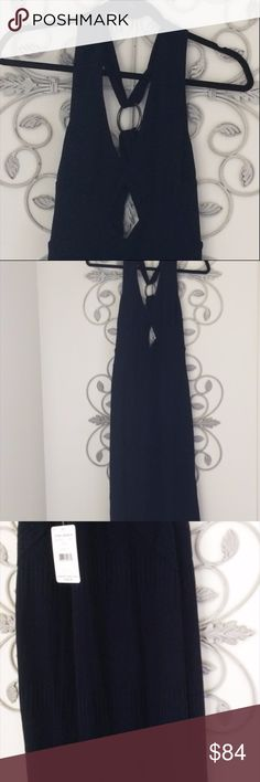 Final $ Free People Navy NWT Sweater Dress $148 S Midi length above ankle. Racerback x design. Polyester. Made in China. Ribbed sweater material with hardware on the back. Still has $148 pricetag on it. Make me an offer! Cutout in back.Very dark navy almost black. Free People Dresses Midi