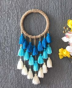 A tasseled dream catcher to add some zing and personality to your room - ₹348