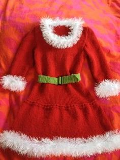 little miss Claus - a knitted child's holiday dress and costume. This one made out of Lion Brand Wool Ease and Fun Fur.