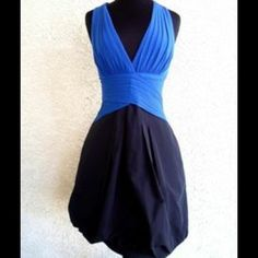 ✨HP✨ BCBGMAXazria bubble hem cocktail dress Royal blue top with bubble hem black bottom cocktail dress. Deep v in front with beautiful top criss cross at neck in back and open back. 3/4 zipper in back for closure. 69% acetate 23% nylon 8% spandex. Never been worn tags are attached. BCBGMaxAzria Dresses