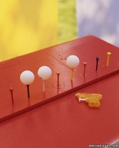 ping pong balls, golf tees and a water gun. Brilliant