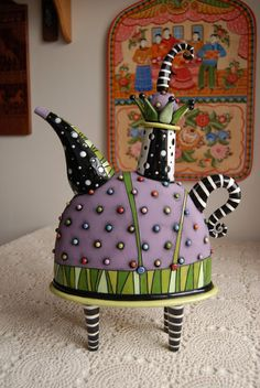 """$495 Hand-built ceramic teapot, measures 15 3/4"""" x 10 1/2"""" x 4 1/2"""". This teapot is functional and is made from white earthenware clay and features the use of some underglaze in addition to the regular glazes."""