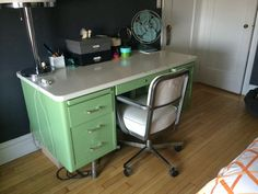 We have my grandfather's vintage steel tanker desk from when he worked at Nationwide Insurance with matching chair. Need to redo it, maybe orange and grey or red and grey (GO BUCKEYES!).