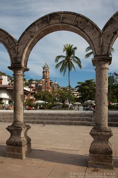 """""""Arcos del Malecón"""" - These Arcos del Malecón and old church were photographed in Puerto Vallarta, Mexico."""