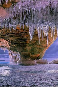 Ice caves in Wisconsin - There's over two miles of caves, frozen ice formations, waterfalls and red sandstone cliffs to be explored.