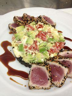 Sesame seared tuna, with black quinoa, avocado feta salad, and tamari glaze.