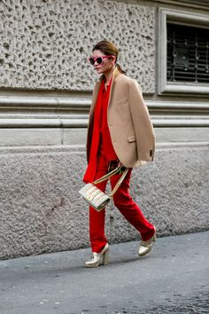Must-See Street Style From Milan Fashion Week Fall 2015 - red pant suit + camel coat, gold heels, and pink cat-eye sunglasses