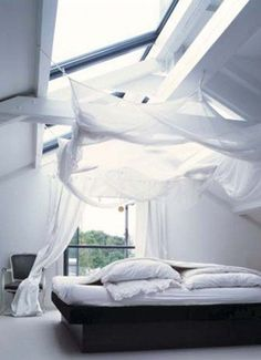 Who knew hanging sheets could have such an ethereal effect? Image via Home Jelly.