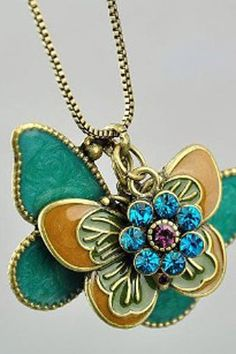 The necklace crafted in alloy, featuring two exquisite butterflies and diamante flower pendant, long seamless gold-tone chain.$15