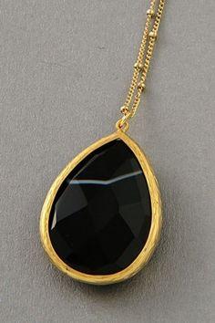 black gemstone necklace.