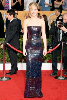 SAG awards 2014 Jennifer Lawrence The American Hustle star wore a form-fitting, strapless, sequined, silk embroidered navy and burgundy gown by Dior Haute Couture that flaunted her amazing physique. She paired her look with Jennifer Meyer jewels.