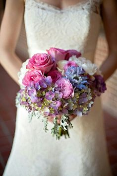 Bride's Bouquet Showcasing: Blue & Violet Anemones, Purple/Green Hydrangea, White Peonies, White Roses, Violet Roses, Pink Roses, & Lace Leaf Dusty Miller