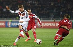Thomas Muller slots home the second for Germany as they comfortably dispatched of Georgia...
