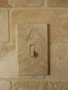 Tumbled travertine switch plates and outlet covers Kitchen