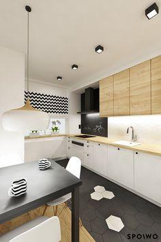 Aranżacja kuchni w dwupokojowym mieszkaniu na Krowodrzy. Matowa czerń, biel i drewno urozmaicone zostały dekoracyjnymi płytkami w kształcie plastra miodu oraz geometrycznymi wzorami na tkaninach i dodatkach.
