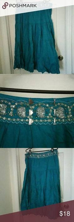 Teal boho gypsy belly dance tribal maxi skirt xl This is an amazing skirt. It is a lovely teal color in the top band has a Tribal Design Zone in with both Gold and Silver Thread clear and gold beads with silver and gold accents. The band also has a portion and located in the small of the back to shorten it and if it is too large. This work great as a dance piece. There are no rips stains or tears and it is in good vintage used condition overdrive Skirts Maxi