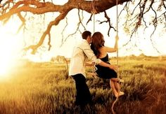 Engagement photo shoot ideas. Swinging in a country meadow.