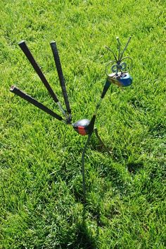 """Golf driver bird recycled garden art. Each bird is unique in height but the usual bird stands 30"""" tall by 18"""" wide. Tail is made out of a 3 golf handles with the head being made out of a wood golf club driver. The body of this bird is made out of a wood driver head."""