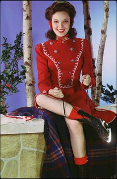 40s sportswear color photo print ad ice skater winter wear red wool military short skirt long sleeves movie star portrait.