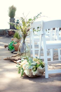 Obsessed with the idea of seashells stuffed with flowers lining the wedding isle. How clever! #beach #wedding #idea