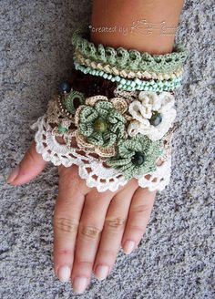Handmade crochet cuff bracelet made of 100 % cotton thread. There are used different crochet techniques in creating this cuff bracelet – Irish crochet for flowers and several lace crochet patterns.  It is a gentle cuff bracelet in boho style with a little vintage look. The main colors are pea green, coffee brown, ivory and beige. For decoration I used four types of beads in different colors.  There are three big flowers decorated with natural stones in different green shades.  This gorgeous…
