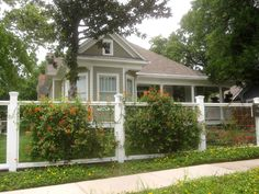 different fence designs for front of house | Another type of fence garden filled with rambling floral vines adds to ...
