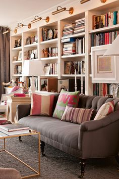 Love the sofa, coffee table, bookshelves, and lighting