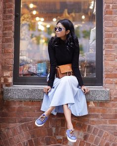 Sheryl of WalkInWonderland in a chic midi skirt and our Flower sunnies