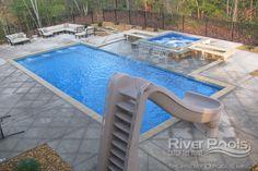 slide-water-feature-runoff-jets-black-fence-handrail-inground-rectangular-fiberglass-pool-photo